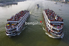 Desperate Eid-ul- Fitr holidaymakers mount the rooftop of launches. (Bengal Pix Limited) Tags: voyage above trip travel people man color colour male men tourism rooftop water horizontal standing asian outside movement asia day asians tour carriage adult outdoor crowd transport floating lifestyle environmental aerialview vessel landmark aerial desperate mount human mature journey transportation males environment daytime dhaka launch adults bangladesh crowds carry waterway developingcountry developingcountries carrying crowded sadarghat homebound southasia thirdworld southasian bangladeshi developingworld subcontinent olddhaka riverine touristpoint carriageway southasians bangladeshis majorityworld burigangariver