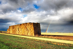 Ancha es Castilla (Mimadeo) Tags: road storm field grass yellow clouds rural way square golden countryside rainbow path farm country harvest meadow sunny stormy stack haystack hay bales bale pathway