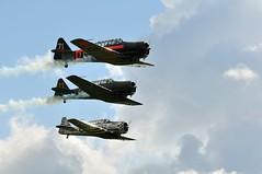 AT-6 Harvard – SK16 (Arndted) Tags: sky airplane flying nikon sweden aircraft aviation harvard airshow at6 d90 borås at6harvard viared sk16 ex100300f4 boråsairshow viaredflygfält