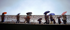 Umbrella Parade (.martinjakab) Tags: x100t fujifilm padlocks makartsteg salzburg austria people streetphotography personen umbrella bridge