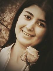 Portrait. (ginasorayakosman) Tags: portrait girl iraq irak holland dutch woman photography portraitphotography flower rose pink