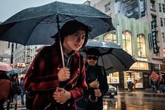 Woman in the rain (feldmanrick) Tags: sanfrancisco streetphotography street unposed candid umbrella woman beautiful color colorful rain decisivemoment outdoor h