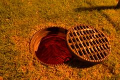 Enter The Underworlds... (JAZ-art) Tags: storm water drain drains draining urban urbex explore exploring underground jazart lid manhole metal light paint painting