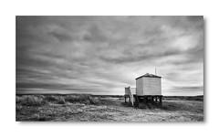 Under Leaden Skies (littlenorty) Tags: atmophere bw beach beachhut bournemouth hengistburyhead landscape lonely moody remote storm