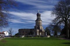 in a pleasant green (Sundornvic) Tags: church shrewsbury shropshire stchads town centre quarry park grass trees blue sky clouds light tower cross