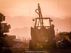 Agri-Industrial sunrise (frattonparker) Tags: nikond7000 sigma150500mm bigma raw lightroom6 sunrise tractor woodpile pylons trees isleofwight frattonparker btonner morning vertorama verticalpanorama