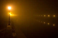 Lights and darkness (Michel Noussan) Tags: pisa italy fog lights river