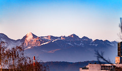 Juxtaposition (Tom Mrazek) Tags: sky landscape sunset winter spring abstract colors bokeh snow summer evening vivid alps slovenia sports vibrant zeiss ljubljana mountains