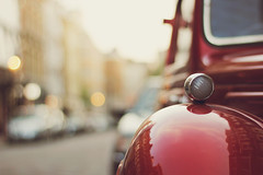 Let's go (ninasclicks) Tags: car red bokeh reflections street warmth travel light