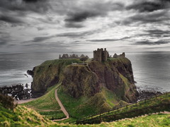 Dark Skies over Dunnottar Castle. (Flyingpast) Tags: castle dunnottar scotland scottish moody clouds historic history fortress pretty scenic scenery coast greatbritain outdoors rock seascape landscape atmospheric visitscotland stonehaven goodfriday sea beach uk cliffs fence path horizon romantic dramatic dunnottarcastle spring