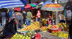 Cusco Market (kate willmer) Tags: fruit orange colours people market umbrellas cusco peru
