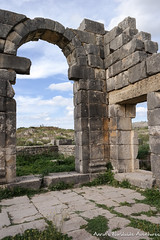 Looking Through a Doorway at the Roman Ruins of Volubilis (adventurousness) Tags: moulayidriss spring2017trip unescoworldheritagesite worldheritagesite arch door maroc meknes morocco roman ruinsromanruins travel unesco volubilis