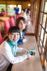 Two women in cafe, holding digital tablet (Apricot Cafe) Tags: img28614 1819years 3034years asia asianandindianethnicities cafe japan japaneseethnicity kyotojapan sigma35mmf14dghsmart casualclothing charming cheerful day digitaltablet enjoyment freedom happiness indoors lifestyles lookingatcamera onlywomen photography relaxation restaurant sitting smiling springtime teenager toothysmile twopeople vertical waistup weekendactivities women youngadult kyōtoshi kyōtofu jp