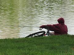 Fishing on the Tidal Basin (Dan_DC) Tags: fishingrod fisherman young hoodedjacket bicycle greengrass tidalbasin pond water sitting washingtondc