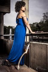 Wonder Women - Samantha Kane (3) (FightGuy Photography) Tags: blue dress bluedress sword weapon blade khopesh blackmodel modelofcolor curlyhair heels highheels strobist railing