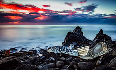 Wrecked (Kent Wilkins) Tags: sunrise gold coast queensland australia tinnie boat wreck broken rocks water ocean long exposure beach