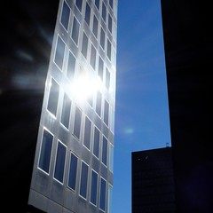 Solar Reflection Through Gap (Shen_Stone) Tags: blue windows england sun london silhouette buildings sunrays euston shenstone fujifilmx20