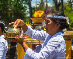 Holy water (Arnaumb) Tags: travel flowers people bali white color colour men beach indonesia 50mm community women dress religion pray ceremony hats traditions blessing ritual mf nikkor hindu ai offerings d600 galungan earthasia