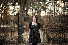 Darcie (veronica_barnes) Tags: red portrait black fashion model woods gate dress lace tights eerie portraiture mysterious mystical conceptual ornate whimsical braid stoic