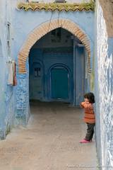 A girl plays hide and seek in Chefchaouen medina (adventurousness) Tags: bluecity chefchaouenthebluepearl thebluecity blue chaouen chefchaouen morocco travel girl medina
