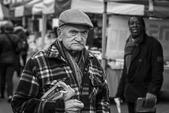 The Harsh Reality (Leanne Boulton) Tags: people monochrome portrait urban street candid portraiture streetphotography candidstreetphotography candidportrait streetportrait streetlife eyecontact candideyecontact old aged elderly man male face facial expression look emotion feeling eyes cap unhappy misery sadness anger tone texture detail depthoffield bokeh naturallight outdoor light shade shadow city scene human life living humanity society culture town canon 5d 5dmarkiii canon5d 70mm character ef2470mmf28liiusm black white blackwhite bw mono blackandwhite nuneaton warwickshire england uk