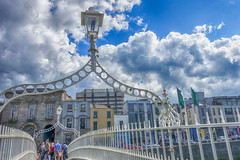 As Clouds Go By (gabi-h) Tags: hapennybridge dublin ireland clouds cloudy sky blue white fence fencefriday gabih archway tourists summer beautifulday walking lantern lightstandard people flags wroughtiron architecture windows cars