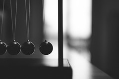 Pause (Sober Rabbit) Tags: blackwhite closeup minimal motion pause newtonscradle stilllife order quite reflections shapes sphere