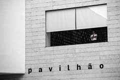 Watchers Will Be Watched (Cornelli2010) Tags: canonef70200mm14l canoneos5dmarkiii bw blackandwhite candid guard guardian lisboa lisbon lissabon pavilion pavillon people portugal sw schwarzweis security selectivecolor streetphotography watcher expo