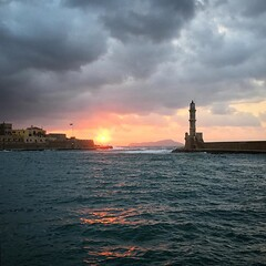 Moody sea at sunset #lighthouse #chaniaoldtown #visitchania #crete #fernweh #travelphotography #aroundtheworld #seascape #sunsetgram #moodytones (mimoabroad) Tags: storm cloudy venetian water sea seascape port harbor oceanscape crete greece chania sunset lighthouse instagramapp square squareformat iphoneography