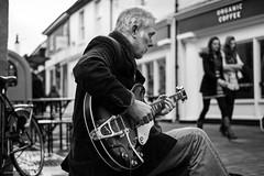 Diary of a Busker (Silver Machine) Tags: winchester hampshire busker busking guitar guitarist folk epiphone bigsby roland sitting walking outdoor people acoustic rock mono monochrome bw blackwhite fujifilm fujifilmxt10 fujinonxf35mmf2rwr