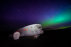 Sólheimasandur (miguel_lorente) Tags: wreck iceland beach astrophotography auroraborealis alpha sólheimasandur stars sky usnavy sony blacksand dc plane aurora
