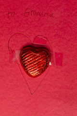 To Grandma (adamopal) Tags: canon canon7d canon7dmarkii canon7dmkii valentinesday chocolateheart candyheart constructionpaper artsandcrafts valentines day grandma chocolate heart candy construction paper arts and crafts shiney macro red