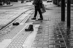 Missing (RaminN) Tags: oregon portland pdx pedestrian street curb shoes