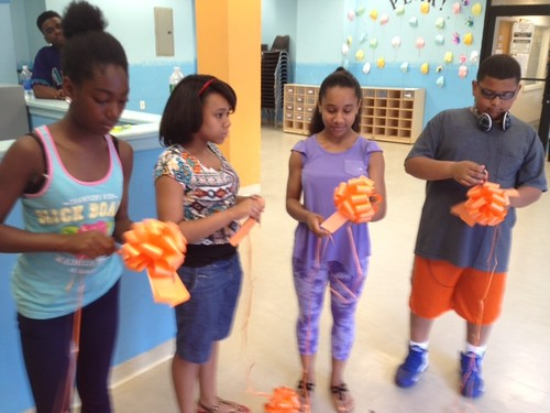 "Students creating the orange ribbons • <a style=""font-size:0.8em;"" href=""http://www.flickr.com/photos/87593247@N02/9453091106/"" target=""_blank"">View on Flickr</a>"