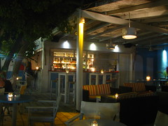 Wandering around at bars at night (Carl_Barks) Tags: longexposure summer vacation people tree bar night island lights candles mediterranean nightshot noflash couch greece antiparos
