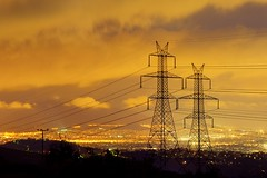 Wired (Vassilis Spiliotopoulos) Tags: orange night powerlines wires citylights