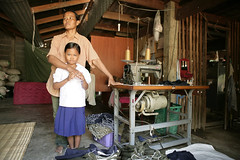 Growing Up Healthy in Thailand (The Global Fund) Tags: family home thailand child aids hiv sewing mother machine medicine seamstress treatment globalfund vision:people=099 vision:face=099