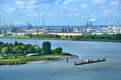 Antwerp : The industrial harbour  area / The Scheldt River (Pantchoa) Tags: river landscape nikon europe industrial belgium belgique harbour belgi area antwerp nikkor anvers flanders fleuve scheldt rawfile d90 flandre escaut 1685f3556gedvr vision:mountain=0557 vision:outdoor=099 vision:sky=092 vision:clouds=0694