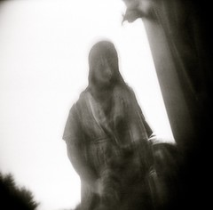 Haunted Icon I (liquidnight) Tags: old blackandwhite bw film monument monochrome cemetery graveyard statue bronze oregon analog mediumformat religious death holga blurry lomo lomography memorial mourning religion toycamera statues delta eerie graves haunted spooky mysterious mementomori haunting dreamy christianity analogue salome catholicism expired statuary vignetting ilford ilforddelta400 crucifixion grief anguish symbolism stboniface mortality willamettevalley 120cfn saintboniface mourners bereavement sublimity thethreemarys priestsmonument priestsmemorial cemeteryofholyangels