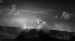 North Shore Magic (McSnowHammer) Tags: bw clouds point ir mono hawaii oahu air north rocky wave surfing flip shore northshore infrared flynn rockypoint novak backflip