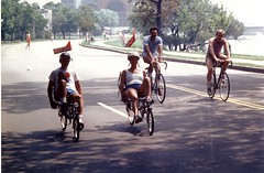 "Four Bicyclists on Memorial Drive"" (Cambridge Room at the Cambridge Public Library) Tags: colorprintsphotographs seymorechet chettseymore cambridgemass charlesrivermass photography19801990 photographycompetitions"