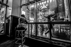 Behind the Glass (Mario Rasso) Tags: newyork manhattan blackandwhite blancoynegro blackwhite starbucks girl usa unitedstates nikon d810 rain umbrella chair raining
