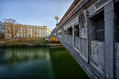 Dragons' bridge (marko.erman) Tags: ljubljana ljubljanica slovenija slovenia bridge dragons concrete secessionstyle architecture monument sunset sony perspective uwa wideangle city travel popular decorated flowers reflections