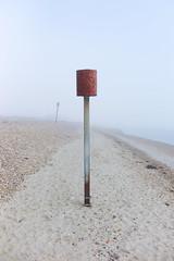Dawn mist (Andrew Malbon) Tags: leica leicam9 m9 rangefinder handheld shore solent misty mist seaside seafront seasonal seafog lowtide lowlight depthoffield shortdepthoffield minimal landscape islandcity summilux 35mmf14 35mm wideangle wideopen muted colour