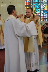 Fr. DeMartinis vests Deacon Boyd