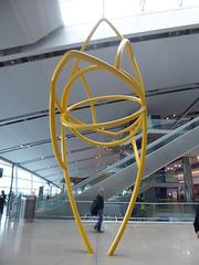 The yellow sculpture (seikinsou) Tags: spring kenyatour udp urbandevelopmentprogramme ireland dublin airport sculpture terminal2 arrival yellow