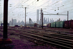 Lower Manhattan and the World Trade Center on a rainy day as seen from the Pennsylvania Railroad a few blocks north of Exchange Place. Within two years, these tracks would also join all the other abandoned railroads in Jersey City. June 1972 (wavz13) Tags: oldphotographs oldphotos 1970sphotographs 1970sphotos oldphotography 1970sphotography vintagephotographs vintagephotos vintagephotography filmphotos filmphotography newyorkphotographs newyorkphotos oldnewyorkphotography oldnewyorkphotos vintagenewyork vintagemanhattan vintagenewyorkphotography vintagenewyorkphotographs vintagenewyorkphotos oldworldtradecenter vintageworldtradecenter twintowers originalworldtradecenter railroadphotos railroadphotography railroads vintagerailroads vintagerailroadphotography oldrailroads oldrailroadphotography jerseycityphotographs jerseycityphotos oldjerseycityphotography oldjerseycityphotos oldjerseycity vintagejerseycity vintagejerseycityphotography jerseycityhistory urbanphotography urbanphotos urbanscenes cityphotography newjerseyphotographs newjerseyphotos oldnewjersey vintagenewjersey newjerseyhistory kodachrome oldslides vintageslides vintage35mm old35mm vintagekodachrome oldkodachrome vintageindustry oldindustry vintageindustrial oldindustrial manhattanskyline newyorkskyline newyorkskyscapers 1970smanhattan 1970snewyork oldnewyork manhattanhistory newyorkhistory