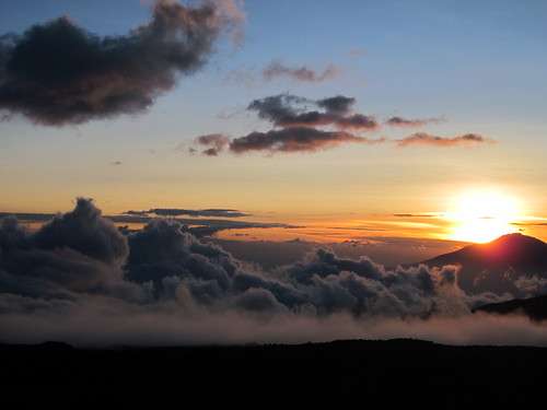 Sun setting behind Mount Meru
