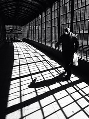 Walking in the Light or the Dark? (joaobambu) Tags: bw berlin germany deutschland shadows sombra german urbano schatten sombras friedrichstrasse berlino berln weidendammerbrcke uploaded:by=flickrmobile flickriosapp:filter=nofilter