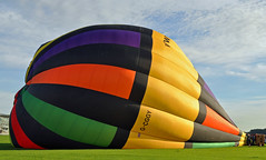 Nearly ready to fly....... (littlestschnauzer) Tags: york uk blue orange hot green its field grass weather yellow fly big high nice nikon october skies basket purple bright stripes air yorkshire side north balloon large silk multicoloured passengers number elements huge ready colourful racecourse ballooning striped bold nearly inflation on 2013 d5000
